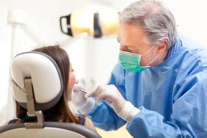 Осмотр у стоматолога