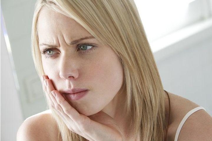 Боль в зубе и горле