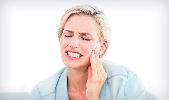 Зубная боль у женщины